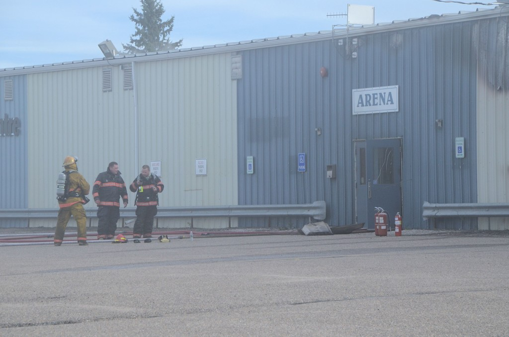 3 firefighters and arena door