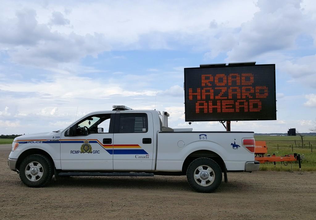 RCMP cruiser - road hazard sign